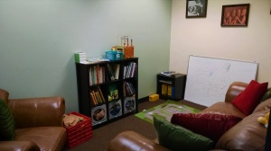 The family room is a comfortable space for adults or kids...even if you are alone, please sit down with a book (or try out the toys...)